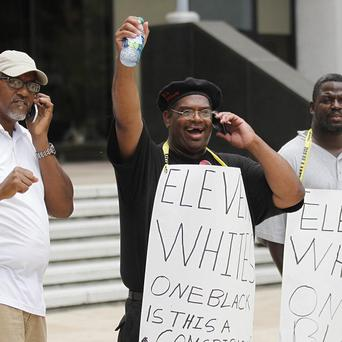 Demonstrators react as they receive word that five officers were convicted over the deadly shootings in New Orlean after Hurricane Katrina (AP)