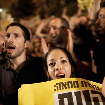 Thousands of Israelis have taken to the streets of the major cities in protest against the rising cost of living (AP)