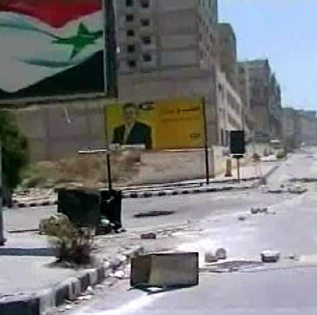 Syrian official news agency SANA photo of the empty streets of Hama after a government assault of the city (AP/SANA)
