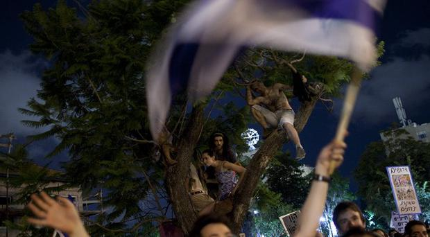More than 250,000 Israelis have taken to the streets to protest over the increasing cost of living (AP)