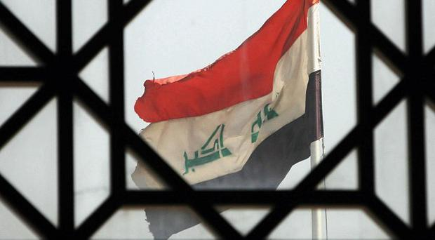 Six civilians have been killed and 14 others injured by bombs planted near two homes in central Iraq