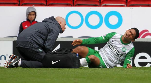 Emilio Izaguirre writhes in pain after breaking his leg against Aberdeen yesterday