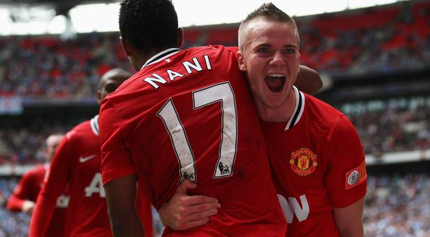 LONDON, ENGLAND - AUGUST 07: Tom Cleverley of Manchester United celebrates with goalscorer Nani after he scores the winning goal during the FA Community Shield match sponsored by McDonald's between Manchester City and Manchester United at Wembley Stadium on August 7, 2011 in London, England. (Photo by Ian Walton/Getty Images)