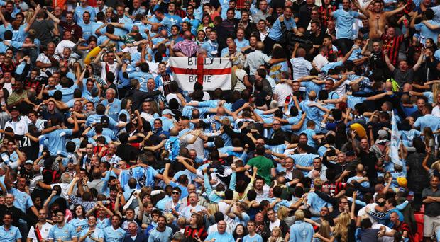 LONDON, ENGLAND - AUGUST 07: Manchester City fans celebrate as Joleon Lescott scores their first goal during the FA Community Shield match sponsored by McDonald's between Manchester City and Manchester United at Wembley Stadium on August 7, 2011 in London, England. (Photo by Ian Walton/Getty Images)