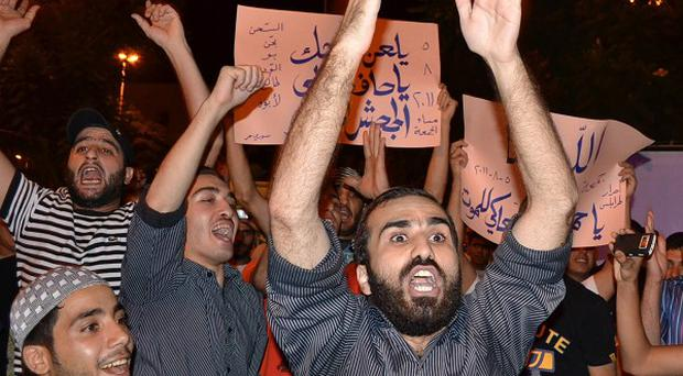 Lebanese Muslim protesters shout anti-Syrian President Bashar Assad slogans during a rally in solidarity with the Syrian people in Lebanon (AP)
