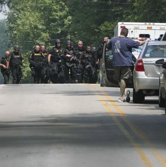 Police officers leave the scene of a multiple fatal shooting in Copley Township, Ohio (AP/Akron Beacon Journal, Karen Schiely)