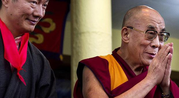 Lobsang Sangay, left, the new prime minister of Tibet's government in exile, stands next to Tibetan spiritual leader the Dalai Lama (AP)