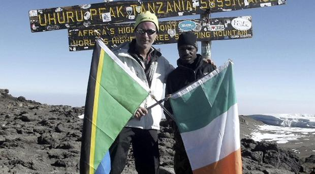 Ian McKeever (left), with Samuel Kinsonga, will attempt to break the speed record for climbing Mount Kilimanjaro