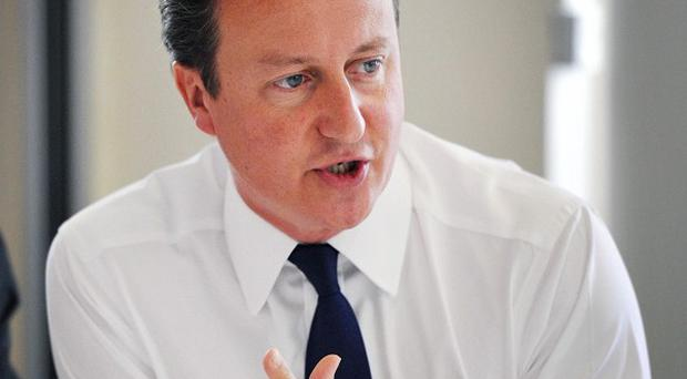 David Cameron is cutting short his holiday to fly back to Britain following a third night of violence in the capital