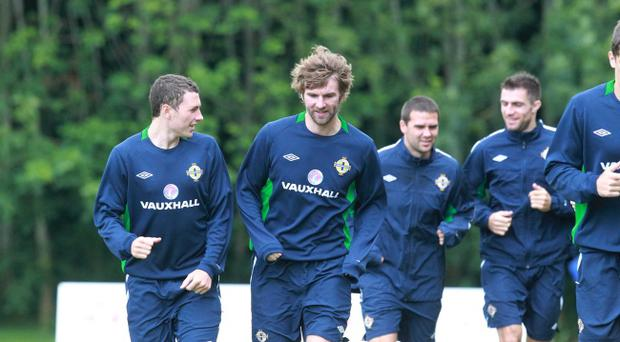 Northern Ireland players Corry Evans and Paddy McCourt along with David Healy and Aaron Hughes during training yesterday