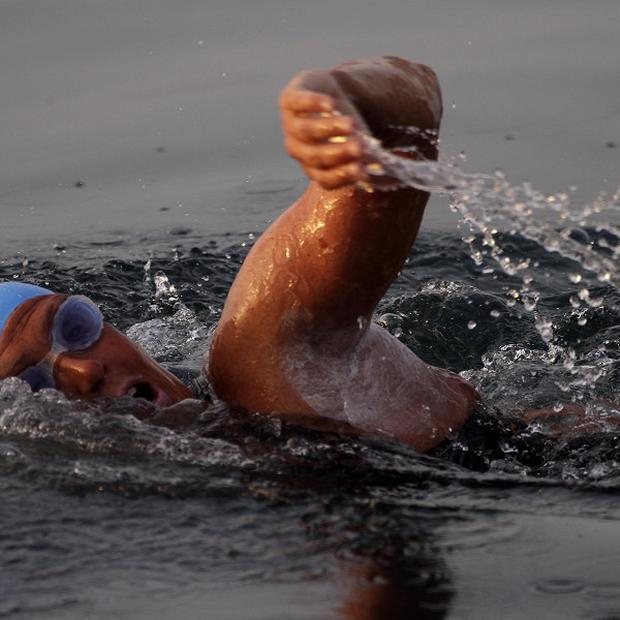 American Diana Nyad , 61, sets off in a bid to become the first person to swim across the Florida Straits without the aid of a shark cage (AP)