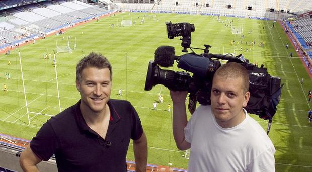 Daybreak presenter Dan Lobb in Croke Park with cameraman Darragh McCarthy (Colm Mahady/Fennell Photography/PA)