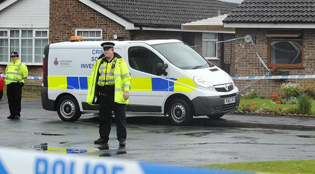 A man has been arrested over the deaths of two women found inside a burning house in Lancashire