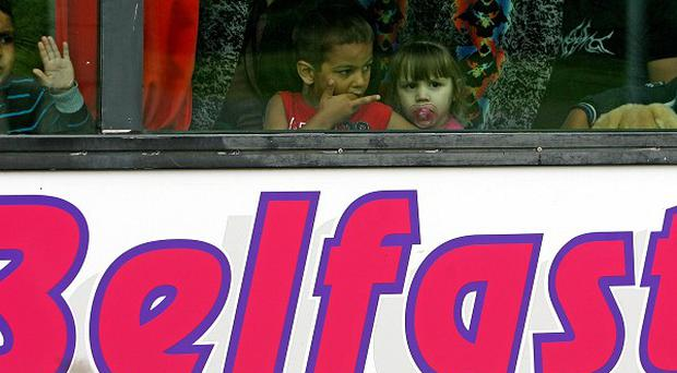 Romanian refugees leave the Lisburn Road area of Belfast on a coach after being forced out by racist groups in 2009