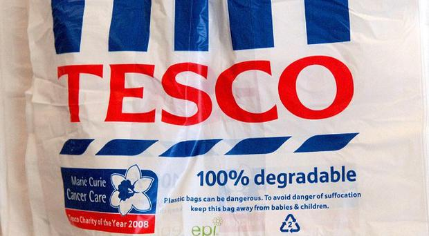 Supermarket giant Tesco denies colluding with other firms to inflate the price of milk and cheese
