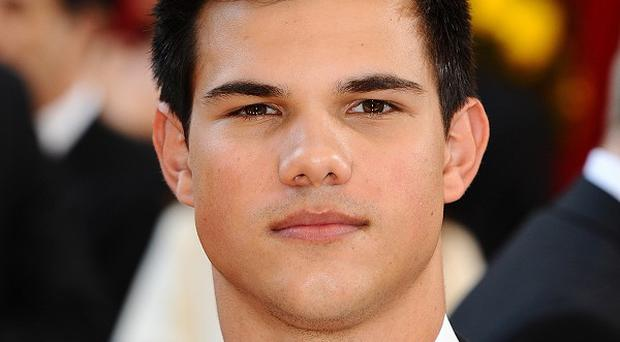 Taylor Lautner says fans won't be disappointed with the Twilight finale