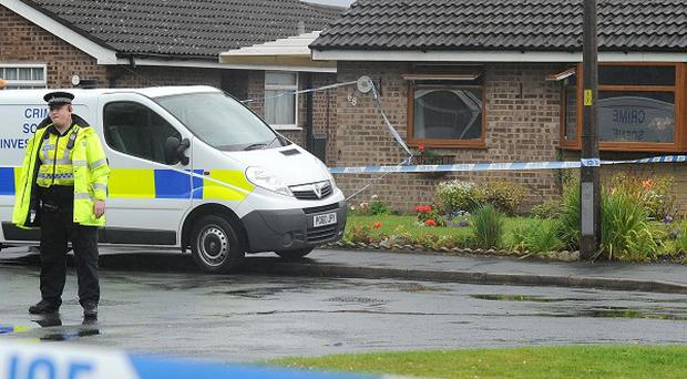 A police officer outside the house in Fulwood, Preston, where the bodies of Maureen and Geraldine Allen were found