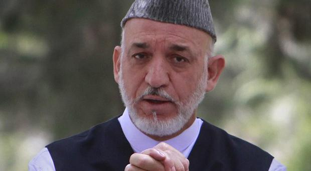 Afghan President Hamid Karzai has stepped in to settle a legal row over parliament(AP)