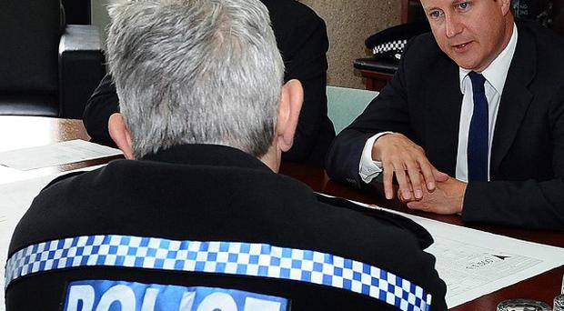 Prime Minister David Cameron meets meets with senior officers from the police, fire and ambulance services