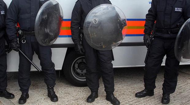 David Cameron is under pressure to reverse the Government's police cuts in the wake of the riots