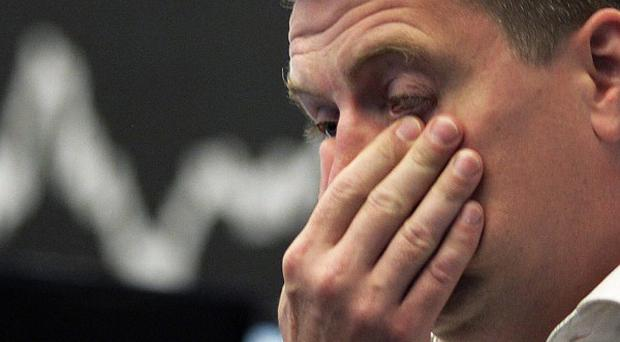 A stock trader reacts as markets slip (AP)