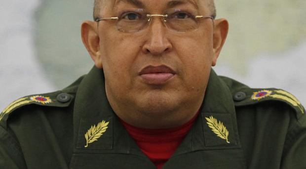 Hugo Chavez issued an order to temporarily halt new admissions to the country's overcrowded and violent prisons (AP)