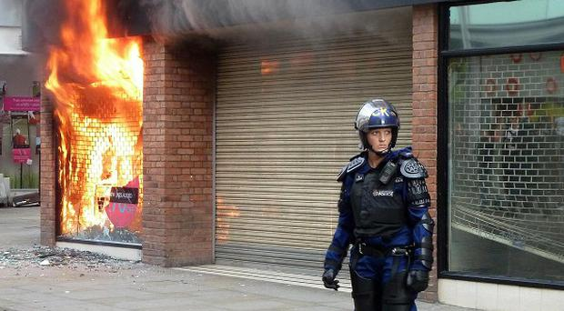 An 18-year-old was arrested on suspicion of arson after a Miss Selfridge store in Manchester city centre was set alight