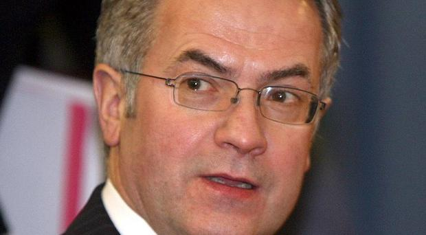 Minister Alex Attwood said the DVA chief executive was suspended pending disciplinary proceedings