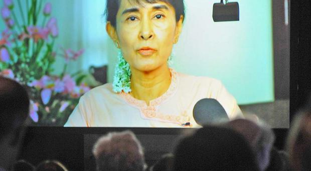 Aung San Suu Kyi has urged the Myanmar and Chinese governments to re-examine the project on the Irrawaddy River