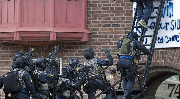 Swedish police make a forced entry into the Libyan Embassy as a group of activists occupied the embassy in Stockholm, Sweden (AP)