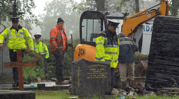 File photo dated 28/06/2011 of forensic officers and Gardai in Urbleshanny graveyard in Scotstown, Co.Monaghan, where they carried out an exhumation after a tip-off that the grave may have been used to bury a teenage IRA victim more than 35 years ago. Forensic tests revealed skeletal remains taken from a graveyard in the Irish Republic are not those of Columba McVeigh.