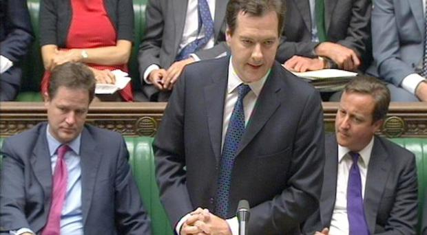 Chancellor George Osborne at the House of Commons yesterday where he updated MPs as stock market turmoil continued