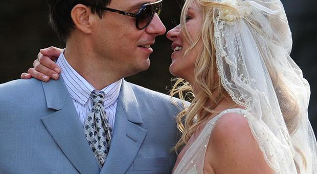 Kate Moss kisses her husband Jamie Hince after their wedding