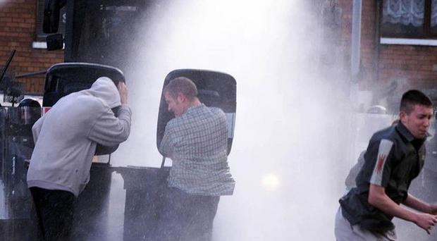 The former head of Northern Ireland's police federation said water cannon would not work for the recent riots in Britain