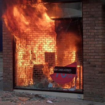 A man has been remanded in custody over a blaze at a Miss Selfridge shop during rioting in Manchester
