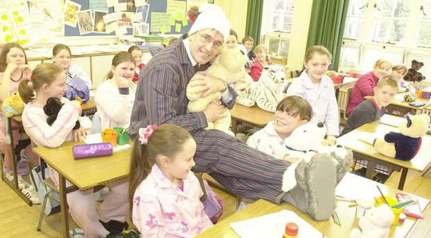 24-10-03. David Hutchinson the principal of Elmgrove Primary School, Belfast, donned his 'jammies' and brough his favourite 'teddy' along to class during the school's Peru for Jesus Day when staff and pupils wore pyjamas. PJD is a charity in Peru where P6 teacher, Karen Steele, is working for the Baptist Mission for a year.