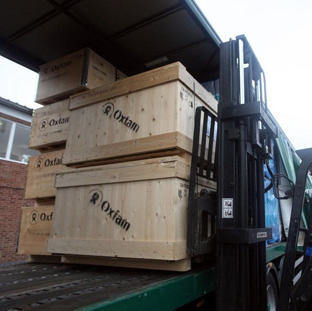 Oxfam loads up aid and equipment bound for Haiti