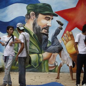 People attend a celebration marking the 85th birthday of Fidel Castro in Managua, Nicaragua (AP)