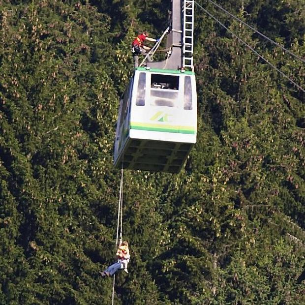 Twenty tourists have been rescued after being trapped overnight on a cable car in the German Alps (AP)