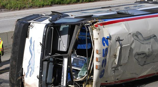 Emergency personnel at the scene where a Greyhound bus flipped on its side in Pennsylvania (AP)