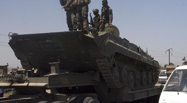 Syrian soldiers have broken up protests in the cities of Damascus and Homs (AP)