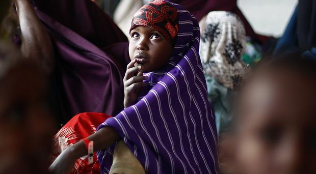 Desperate parents from drought-stricken countries are abandoning their children at the world's largest refugee camp, in Kenya, a charity said (AP