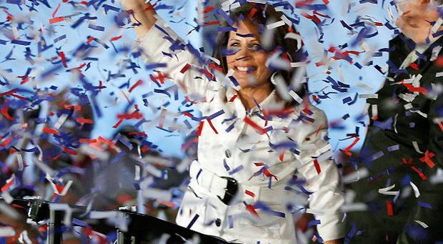 Confetti falls as Republican presidential candidate Michele Bachmann rallies supporters in Ames, Iowa (AP)