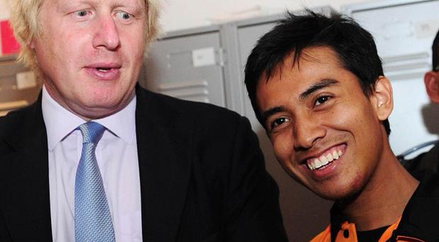 Boris Johnson with Malaysian student Ashraf Rossli, who was mugged during the London riots, at the Badminton World Championships