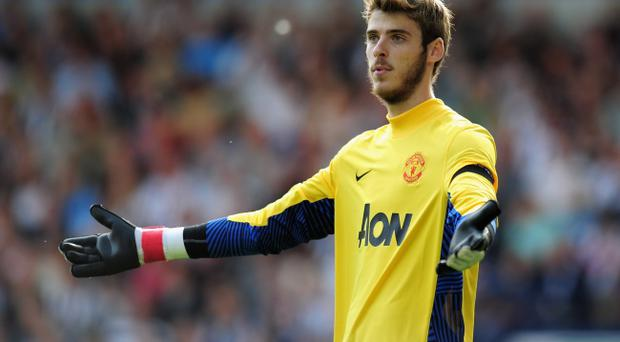 WEST BROMWICH, ENGLAND - AUGUST 14: David De Gea of Manchester United gestures during the Barclays Premier League match between West Bromwich Albion and Manchester United at The Hawthorns on August 14, 2011 in West Bromwich, England. (Photo by Shaun Botterill/Getty Images)