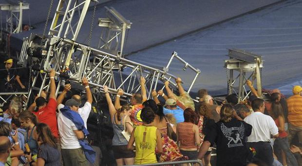 At least four people are dead after a stage collapsed at a state fair in Indiana (AP)