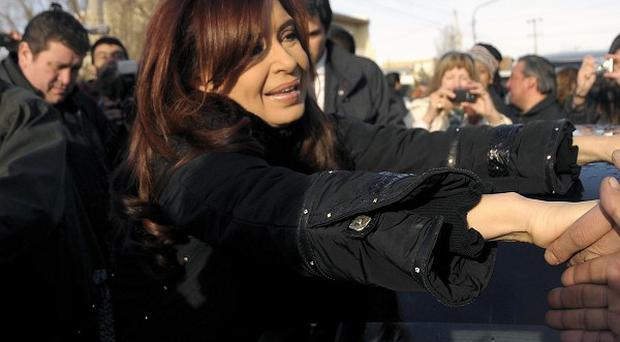 Argentina's president Cristina Fernandez after casting her vote at a polling station in Rio Gallegos, Argentina (AP)