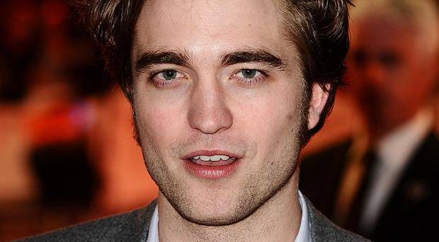 Robert Pattinson plays vampire Edward Cullen in the hit film franchise
