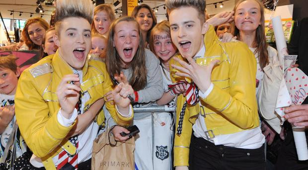 Jedward with some of the fans who queued at HMV in Belfast city centre