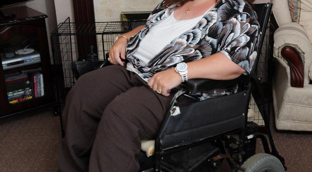 Nicola Nesbit, who has cerebral palsy, was charged an £8 call-out fee on top of her taxi fare